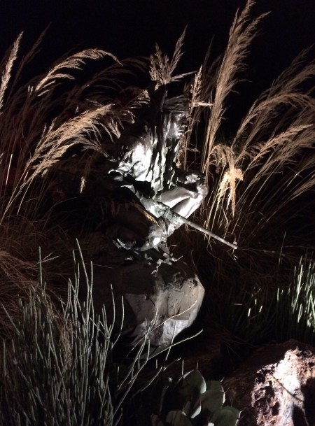 Chiricahua Apache displayed at night with garden lighting